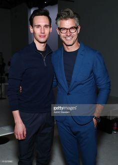 Actors Cory Michael Smith and Eric Rutherford attend the EFM Engineered For Motion Spring/Summer 2018 Runway Show at Skylight Clarkson Square on July 12, 2017 in New York City.
