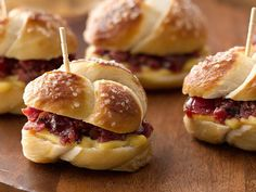 Your Thanksgiving party guests won't be able to resist these pastrami-pretzel bites stuffed with honey mustard, and cherry preserves.