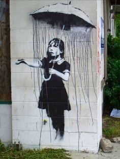Bansky graffiti art.. Rain