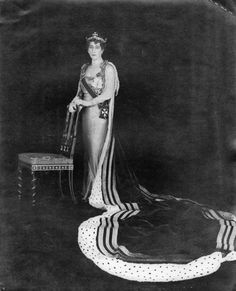 Photograph of Queen Maud of Norway, dressed for the coronation of her nephew, George VI of the United Kingdom, in 1937. She is shown wearing the robes of a British princess and a dress by Worth (both now located at the National Museum of Art/Museum of Decorative Arts and Design, Oslo).