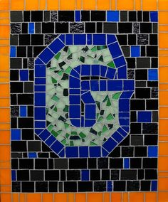 Mosaic Letter G- The Tieton Alphabet  Tieton Mosaic is a mosaic sign company in Tieton, WA specializing in typographic glass mosaic signage