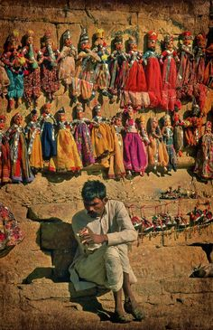 Memories of being given a basket of these puppets for Christmas one year must of been about 11 at the time - ( Puppet seller, Jaiselmer India )