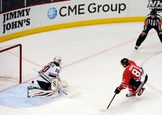 Chicago Blackhawks' Marian Hossa (81) scores the game winning goal on Minnesota Wild goalie Ilya Bryzgalov (30) in a shootout of an NHL hockey game in Chicago, Thursday, April 3, 2014. The Blackhawks won 3-2. (AP Photo/David Banks)