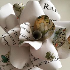 Peter rabbit paper rose - upcycled from the vintage book. Great for children's rooms or book lovers all over the world! What a classic story - we love Peter Rabbit and friends. Beatrix Potter stories are some of our favourites in our house.