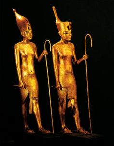 These golden statuettes of King Tut show him wearing the crowns of Upper and Lower Egypt. Photo: Kenneth Garrett, National Geographic / HC