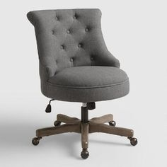 With a distressed gray wood base, charcoal gray polyester upholstery and button tufting, our rolled-back chair lends vintage-inspired character to your home office. It features a plush, round seat with an adjustable height for a comfortable fit and metal casters for easy movement around your workstation.