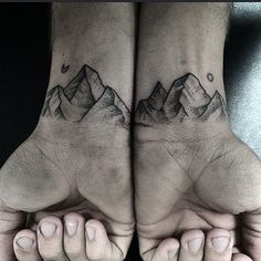 Mountains on the wrists for Darien by Hannah @hannah_novart #wristattoo #frontlinetattoo