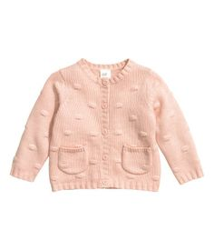 Powder pink. Textured-knit cardigan in a soft cotton blend with buttons at front and patch front pockets. Ribbing at neckline, cuffs, and hem.