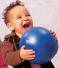 Having a Ball With Musical Ball Play - Tummytime Baby Therapy Ball - - Pinned by #PediaStaff.  Visit http://ht.ly/63sNt for all our pediatric therapy pins