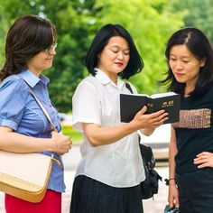 Masako and another sister share a scripture with a woman