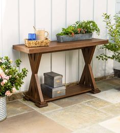 Our Claremont Eucalyptus ConsoleTable is crafted from FSC-certified eucalyptus grandis, so it's naturally weather-resistant and insect-repellent. The multi-step finish offers rich color and gorgeous good looks. This table is the perfect size for serving a buffet, setting out pot luck side dishes or setting up a bar. It can be used indoors or outdoors, wherever you're entertaining. Console Table is also handy for displaying decorative items such as plants. The att Outdoor Console Table, Used Outdoor Furniture, Wood Patio Furniture, Outdoor Side Table, How To Clean Furniture, Round Dining Table, Ikea Lack Coffee Table, Outdoor Bar Cart, White Side Tables