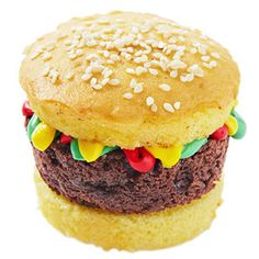 Burger Cupcakes by familycircle: Made of yellow cupcakes and brownie 'burgers'. #Hamburger_Cupcake #familycircle