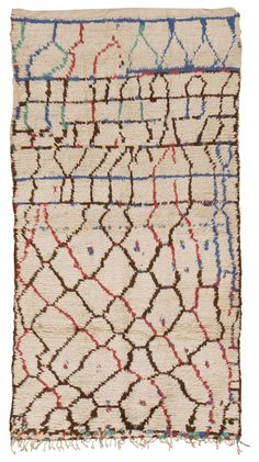 #45293 Vintage Moroccan Rug, Morocco, Mid 20th Century - Going beyond the minimalist color schemes and designs that Moroccan rugs are known for, this unique rug incorporates vibrant accents that flatter the classic ivory and natural fleecy brown color scheme beloved by Le Corbusier and many elite mid-century designers. Linear patterns woven in alternating colors define the abstract honeycomb latticework grid that traverses the field. This vintage Moroccan rug features a geometric latticework ...