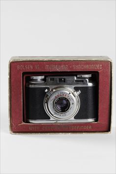 """Vintage Bosley Synchromatic camera in original box with instructions and written history of repairs. Dimensions: Camera: Height: 3-1/4"""" Wide: 4-1/4"""" Camera Box: Height: 4-1/4"""" Width: 6-1/4"""" Fair vinta"""