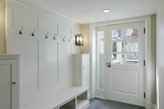 Cameo Homes: Great mudroom with white built-ins and slate tiles floor.