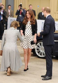 Lady Verulam greets the Duchess Kate with a curtsey