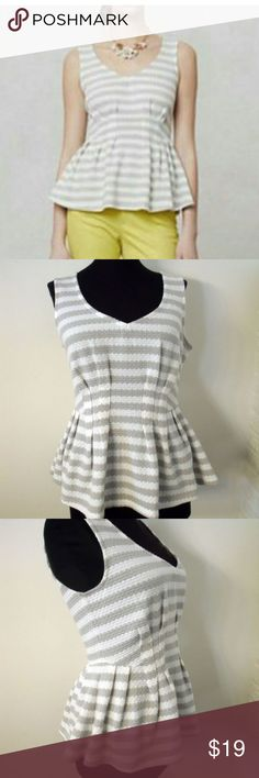 """Anthropologie Gray White Striped Knit Peplum Top Anthropologie Gray and White Striped Stretch Knit Peplum Top - size Small  This darling top features a stretch knit fabric with gray and white stripes with a peplum design.  Very comfortable.  PLEASE MEASURE FOR SIZE  Measurements: 19"""" from underarm to underarm 27-36"""" waist 23"""" from the top of the shoulder to the bottom hem Anthropologie Tops"""