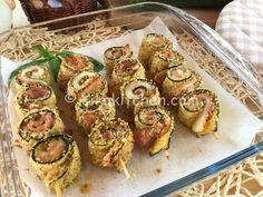 Gli involtini di zucchine gratinate sono un delizioso secondo piatto a base di zucchine farcite con prosciutto e formaggio. Ricetta facile.