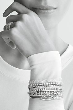 According to stylist Vanessa Traina, when it comes to layering—even with very fine pieces—it's best to not be shy. Tiffany rings and bracelets in 18k white gold and platinum with diamonds.