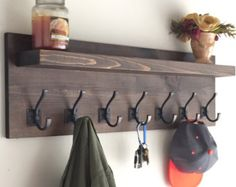Handmade Rustic coat rack with floating shelf and oil rubbed bronze coat hooks. This Rustic Coat Rack measures approximately Barn Wood, Rustic Wood, Articles En Bois, Coat Rack Shelf, Coat Racks, Diy Coat Rack, Wall Coat Hooks, Hanging Coat Rack, Rustic Coat Rack