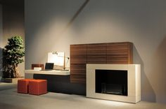"PRESOTTO | Home office I-modulART wall unit. Hanging bench and bioethanol fireplace in ecomalta® beige seta; wall units in ""aged"" tabacco oak. _ Parete home office I-modulART. Panca sospesa e caminetto a bioetanolo in ecomalta® beige seta; pensil in rovere vissuto tabacco."