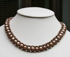 Necklace sewn with Fireline, freshwater pearls and Miyukis 11/0 seedbeads. The lock is in sterling silver is gilded