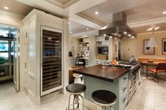 The recently updated kitchen, accessed through a butler's pantry, is outfitted with Viking and Sub-Zero appliances.