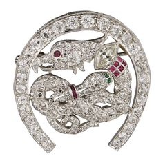 Art Deco Ruby Emerald Diamond Platinum Brooch. Art deco brooch depicting a Serpent battling a Griffin. Round and marquise shape diamonds weighing approximately 4.90 carats. c 1930s