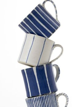 Great for the beach or a blue and white kitchen. Blue stripey coffee cups from Conran Great for the beach or a blue and white kitchen. Blue stripey coffee cups from Conran Pottery Mugs, Ceramic Pottery, Ceramic Art, Thrown Pottery, Slab Pottery, Ceramic Bowls, Picasso Blue, Cerámica Ideas, Keramik Design