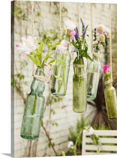 Posies in suspended vintage pop bottles