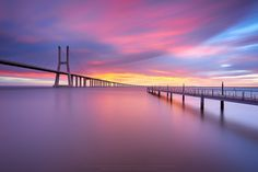 https://flic.kr/p/CYkAjZ | Color Festival ! | Vasco da Gama Bridge - Lisbon  Without any doubt, the best place to watch the sunrise in Lisbon,  an awakening that sometimes surprises and brings to you a color festival.  Nikon D810 + Nikkor AF-S 16-35 f/4 VR ED @ 16 mm ISO 64 - f/8 - 120 sec Filter Used: Formatt/Hitech ND Firecrest 1.8 +  Lee GND 0.9 HE   My Site |  500px |  Instagram |  Google +
