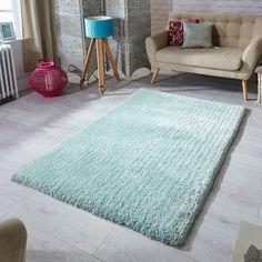 Softness shaggy rugs feature an immensely soft and silky mint coloured pile which will be super soft under foot. Power loomed with a microfibre polyester yarn to create a durable and dense pile which will bring comfort to your living space. Bed In Living Room, Living Room Carpet, Living Area, Nursery Rugs, Room Rugs, Fluffy Rug, Green Carpet, Pink Rug, My New Room