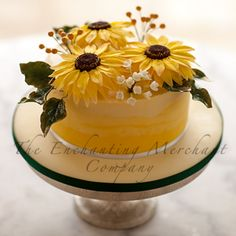 A single tier contemporary, yet elegant yellow ombre buttercream covered...