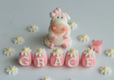 Pink and white cow cake topper set by www.lucys-cakes.com, via Flickr