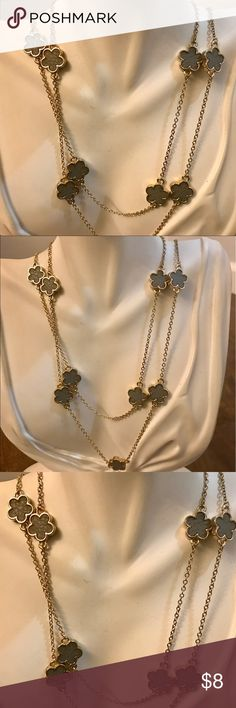Gold Gray Flower Long Necklace Gold Metal Long Necklace with Gray leather Flowers. Never Worn. New without tags Jewelry Necklaces