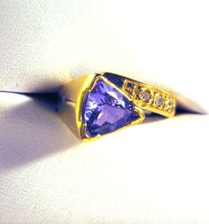 Free Upgrade to Express Shipping/ Tanzanite Trillion Ring in 14k Gold. via Etsy.