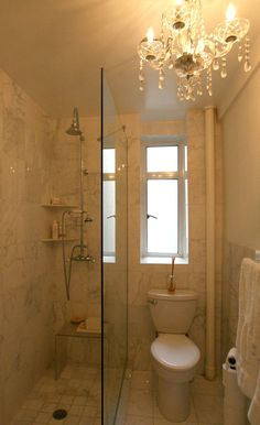 Tiny marble bathroom with a Chandelier! -  To connect with us, and our community of people from Australia and around the world, learning how to live large in small places, visit us at www.Facebook.com/TinyHousesAustralia