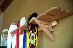 The Vertical Hercules of Ski Racks for the Avid Skier and Ski Family. Our Vercules Series is a vertical ski rack designed to make use of a wall's height rather than its width. This Series holds up to Skateboard Rack, Skateboard Decor, Snowboard, Ski Rack, Wood Grain Texture, Rack Design, Wall Racks, Snow Skiing, Diy Garden Decor