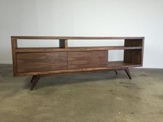 The PorkChop console is a favorite to most. Hand built out of walnut with great attention to detail to last generations. Showcasing traditional mid century design. The focal point to any room, you wont be disappointed. Dimensions: 60or 66 x 16 x 23.5( LxDxH) Interior height roughly 4 and