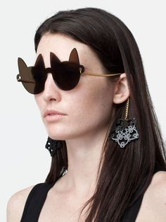 cat-shaped sunglasses - I Still Love NYC's cat-shaped sunglasses are a multifaceted summer accessory made for cat lovers. These super chic shades feature a modern ta...