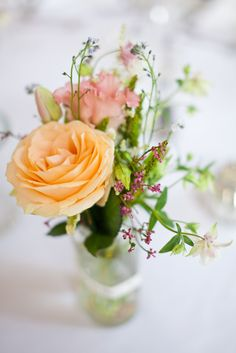 Peach Rose flower stem in glass jar - Image by Natasha Cadman Photography - Tea Length Alan Hannah Dress with Cape for an Urban City Wedding in Leeds with Music Theme, Navy Colour Scheme and Pastel Flowers.