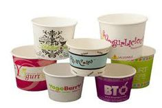 Lots of different designed cups. Top left corner cup has a  detailed design with a bright logo to offset the detail. The Middle cup uses a pale blue as a background for the logo and uses the black outline and type to make it more bold.