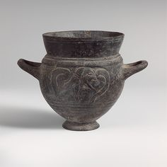 Terracotta drinking cup with two handles | Etruscan | Archaic | The Met
