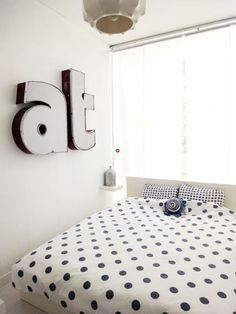 Polka Dots & commerical building letters. cool teen room. Throw in a bright wide horizontal stripe behind the lettering or paint the whole wall for a kick.