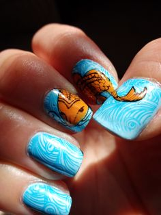 """Koi Nail Art. Used MessyMansion Plate (MM29-Waterworld). Water painted with Ulta """"Faded Blues"""" base and Piggy Polish """"Polar Sea Ice"""" for the stamp.  Koi in Wet n' Wild """"Sunny Side Up.""""  https://www.etsy.com/listing/172604805/nail-art-stamping-image-plate-mm29?ref=shop_home_active_3 #nailart"""