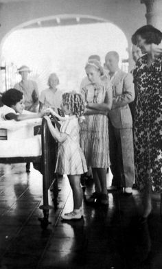 Shirley Temple visiting a hospital for charity, 1936.