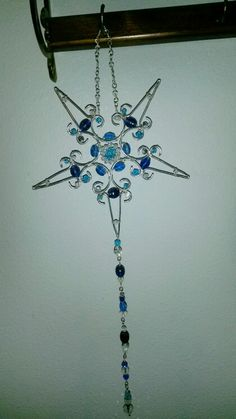 Wire wrapped snowflake. Sun catcher beaded.