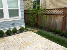 Great design for small space.  By Blessing Landscapes.  Patio Synlawn flagstones.