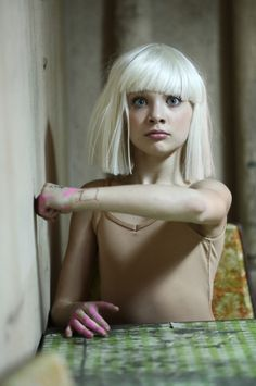 Maddie Ziegler in Sia's Chandelier music video. Chandelier by Sia