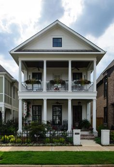 Narrow lot house design. Charleston style row house. Stacked double porches. Southern porches. Amazing curb appeal. Porch plant and flower decorating . Landscape design. - LJKoike